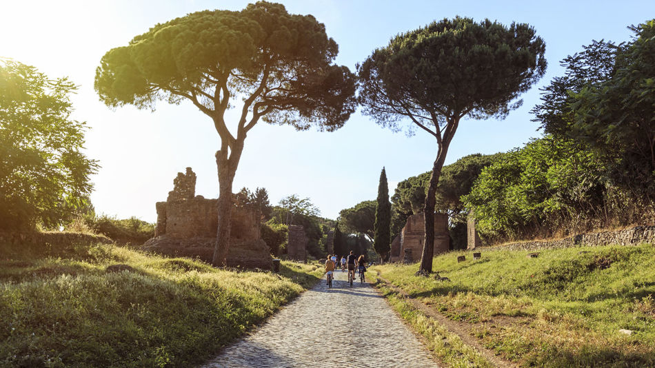 People running over the ruins of the ancient Via Appia (Appian Way) in Rome and man Appian Way Coliseum Quirinale Rome Via Appia Antica Viminale Europe Fori Romani Italy Trevi