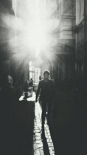 Silhouette of woman walking on city street