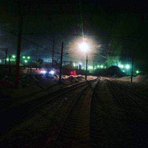 Illuminated railroad tracks against sky at night