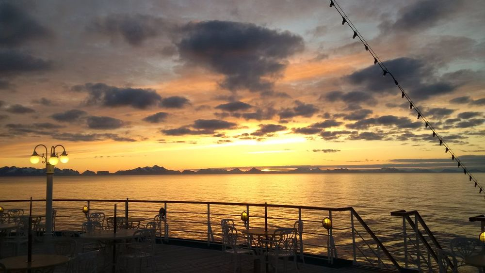 Morning Sky Norway🇳🇴 Ship Life Amber Sky Beauty In Nature Blue Cloudy Sky Cloud - Sky Horizon Over Water Nature No People Norway Summer Norway Water Orange Color Outdoors Railing Scenics Sea Silhouette Sky Sunset Tranquil Scene Tranquility Water