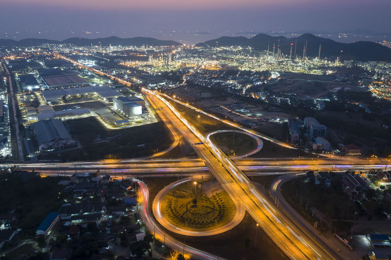 Long exposure from drone head light on free way and intersections ring road at night city