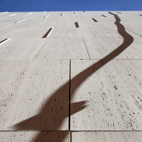 High angle view of shadow on footpath during sunny day