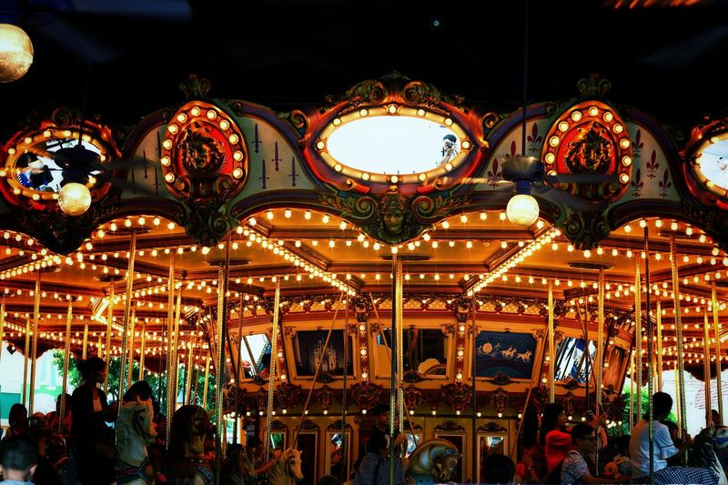 Low angle view of illuminated carousel at night