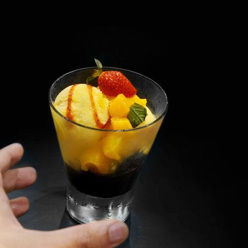Grabbing a gelato cup Dessert Gelato Grabbing A Bite Black Background Close-up Cup Food Food And Drink Freshness Fruit Grabbing Healthy Eating Holding Human Hand Ice Cream Studio Shot
