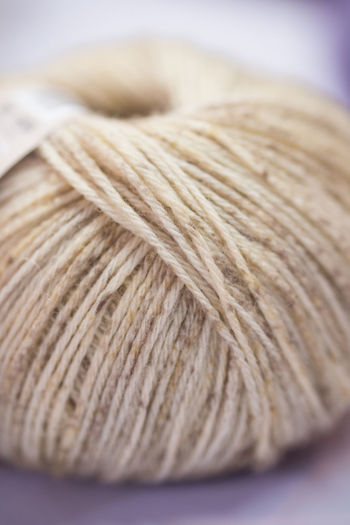 Close-up Wool Indoors  Thread Textile Ball Of Wool Art And Craft Selective Focus Craft Knitting Material Still Life Creativity Studio Shot Simplicity Textured  Pattern Focus On Foreground Softness Indoors  No People Art And Craft Table Creativity Food And Drink
