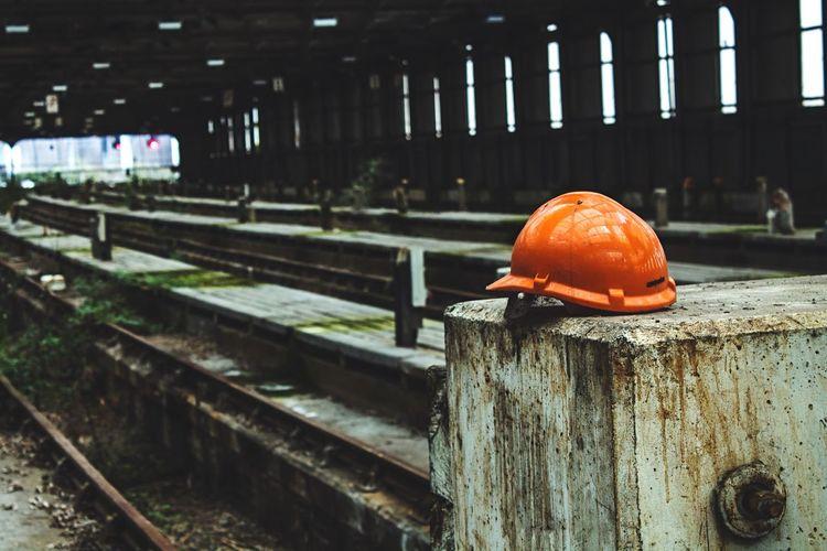Hardhat on ledge in abandoned factory