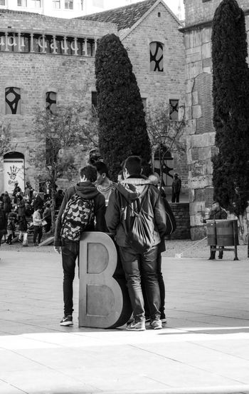Architecture Built Structure Real People Building Exterior Outdoors City People The Street Photographer - 2017 EyeEm Awards Street Photography Streetphotography Architecture B Barcelona Blackandwhite Lyric  BYOPaper! Black And White Friday Stories From The City Focus On The Story #urbanana: The Urban Playground
