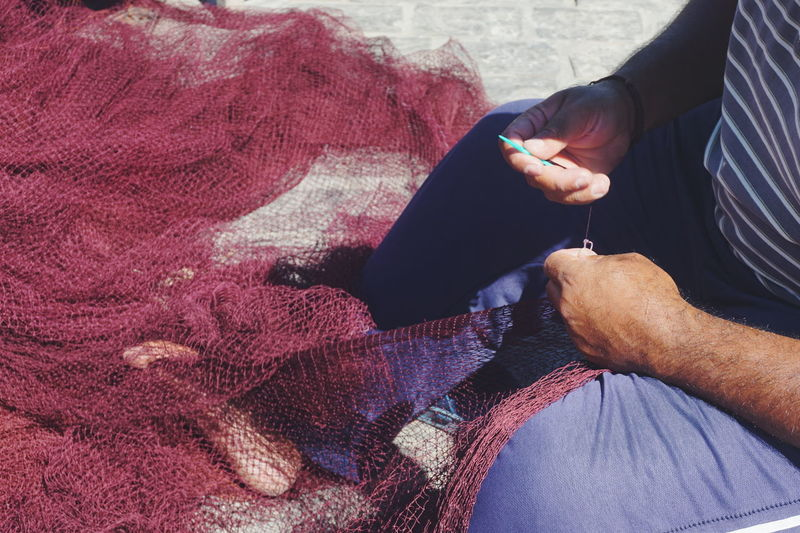 Repairing fishing nets Fishing Net Hands Hands At Work Repairing Adult Day Fisherman Fishing Human Body Part Human Hand Indoors  Lifestyles Naousa Naoussa One Person People Real People Senior Adult Sitting Textile Women The Week On EyeEm