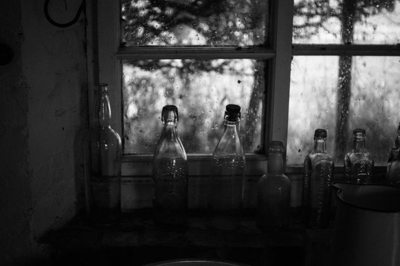 Abandoned Bathroom Blackandwhite Blackandwhite Photography Bottle Container Day Digital Composite Domestic Bathroom Domestic Room Glass - Material Home Household Equipment Indoors  Mirror Real People Reflection Sitting Table Transparent Window Women