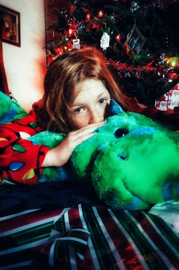 Up Close Street Photography My Little Girl After Gifts Early Morning Loves Family From My Point Of View EyeEm Best Shots So Sleepy Dinosaur Pillowpet Wrapping Paper Aftermath
