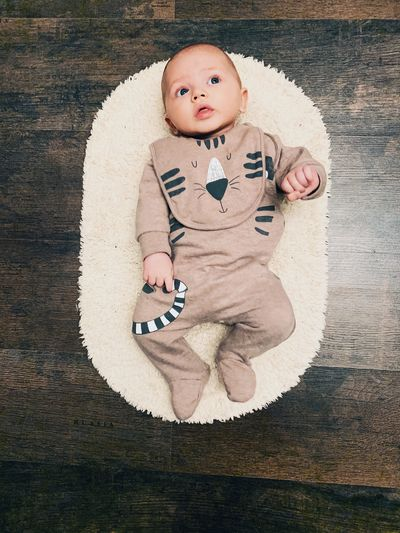 Child Childhood Full Length Innocence Cute Portrait Baby One Person Indoors  High Angle View Babyhood Males  Toddler  Lying Down Boys Flooring Wood Softness Baby Boy Newborn