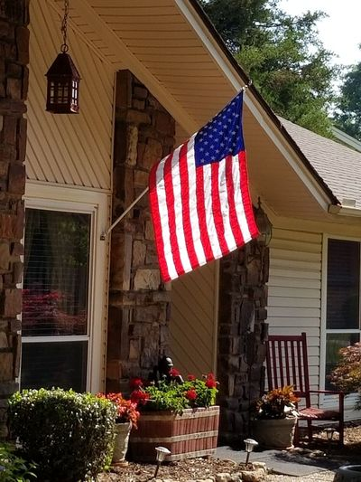 Multi colored flags hanging outside house
