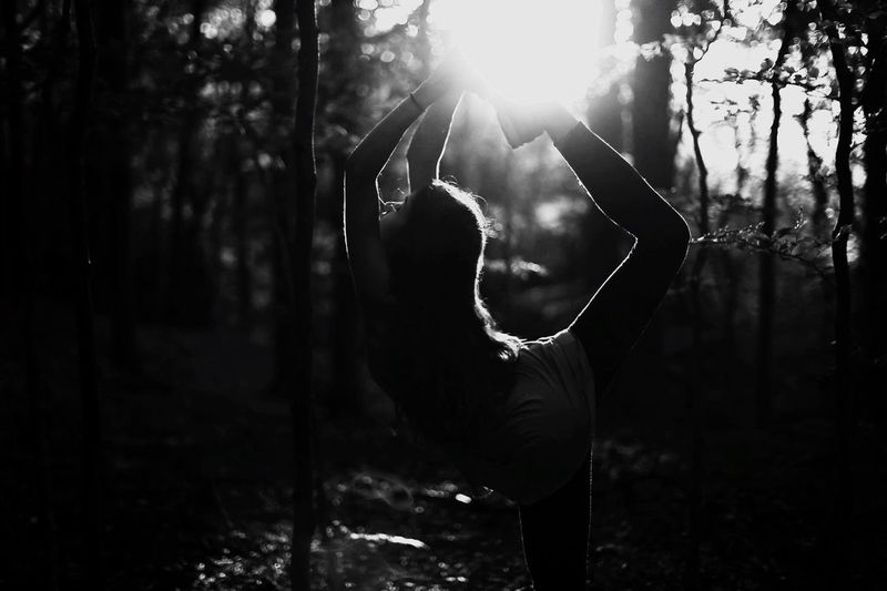 Young woman exercising in forest