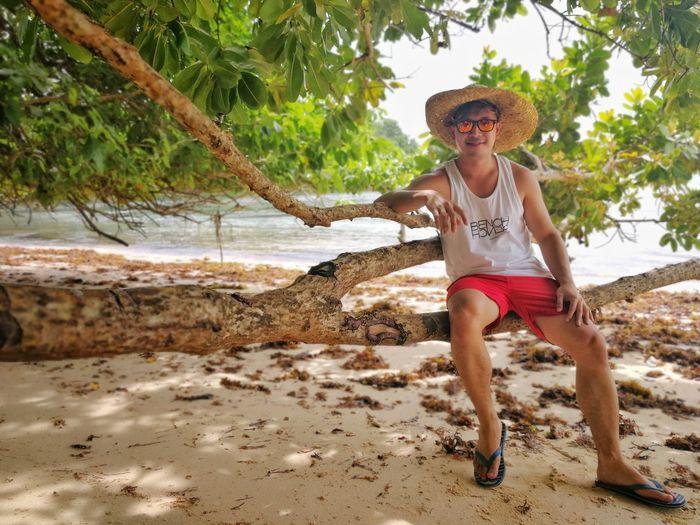 Full length portrait of man on beach