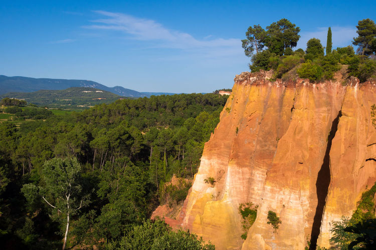 Ochre cliff Ochre Provence Blue Sky Clay Cliff Color Landscape Nature No People Ocre Outdoors Roussillon Scenics