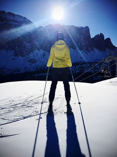 Snow Winter Cold Temperature Season  Sunbeam Sunlight Weather Tranquil Scene Mountain Full Length Leisure Activity Shadow Covering Beauty In Nature Scenics Vacations Landscape Tranquility Lifestyles Nature Ski Skiing People Sport Tourism
