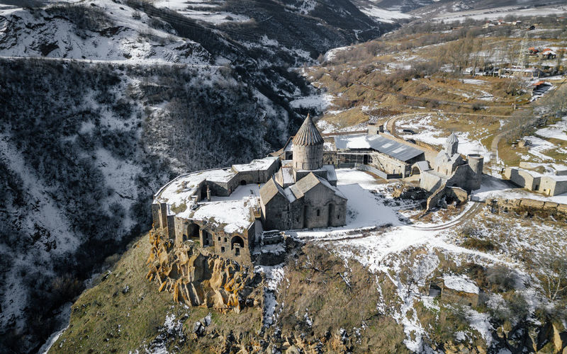 High angle view of buildings on snowcapped mountain