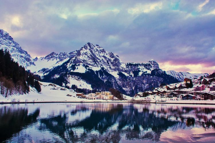 Village in snow Mountain Reflection Sky Nature Beauty In Nature Snow Lake Mountain Range Scenics Tranquility Water Tranquil Scene Waterfront Cloud - Sky Outdoors No People Winter Day Cold Temperature Range EyeEmNewHere Shades Of Winter Shades Of Winter An Eye For Travel