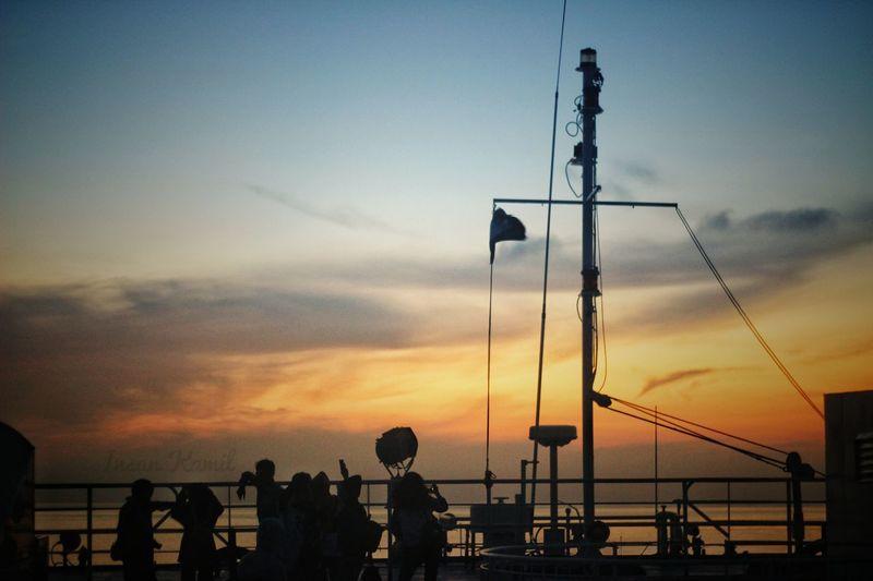 Sunset at Lembar Harbor Sunset Sea Stoplight Silhouette City Sky Cloud - Sky Shore