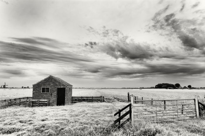Shed In A High Key Landscape Beauty In Nature Built Structure Cloud - Sky Day Grass Landscape Nature No People Outdoors Scenics Sky Tranquil Scene Tranquility Wooden Post