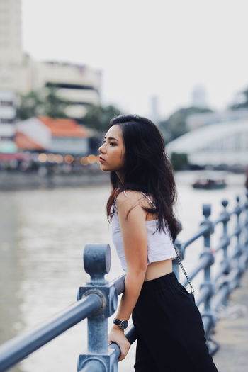 SHAMINE Singapore One Person Young Women Young Adult Focus On Foreground Hair Real People Standing Three Quarter Length Architecture Railing Black Hair Side View Lifestyles Looking Beautiful Woman Beauty Hairstyle Leisure Activity Looking Away Water Outdoors Looking Over Shoulder Contemplation