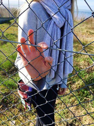 One Person Real People Fence Holding Grass Lifestyles Outdoors Day Field Men Chainlink Fence Human Body Part Human Hand One Man Only Domestic Animals Only Men Nature Adults Only Adult People Love Friends Girl Bohem Long Goodbye EyeEmNewHere Live For The Story