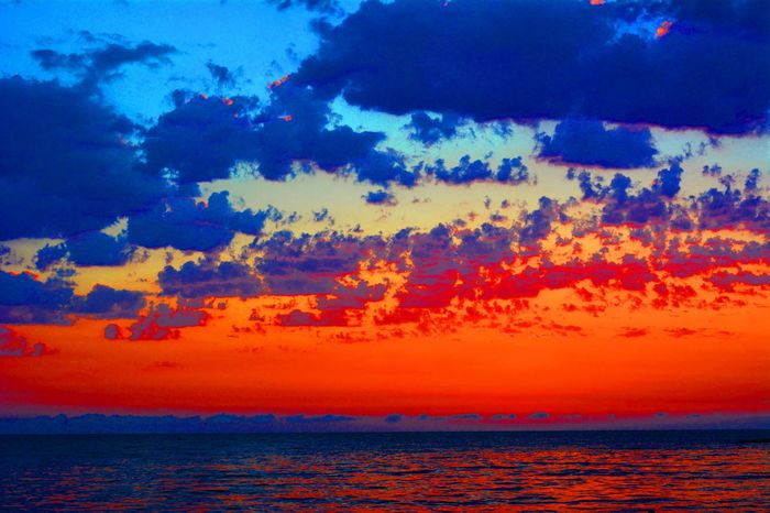 Sunset Sea Horizon Over Water Outdoors Multi Colored Water Red Blue No People Silhouette Sky Scenics Cloud - Sky Beach Horizon Landscape Nature Saturated Color Wave Beauty In Nature