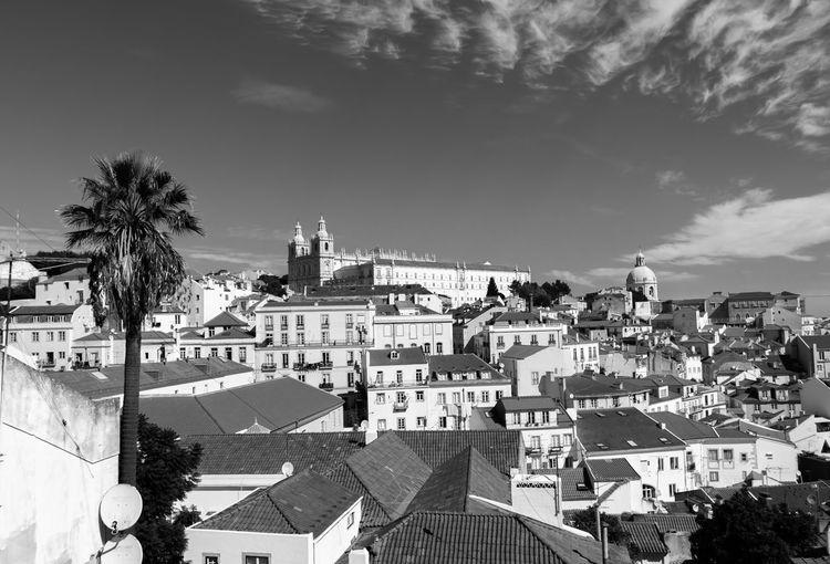 Historic Churches In City Against Sky Seen From Miradouro De Santa Luzia