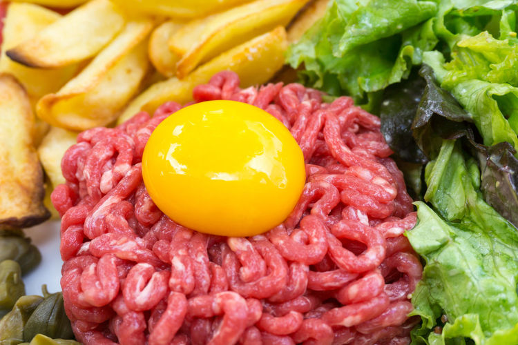 Close-Up Of Steak Tartare With Leaf Vegetables And Prepared Potato