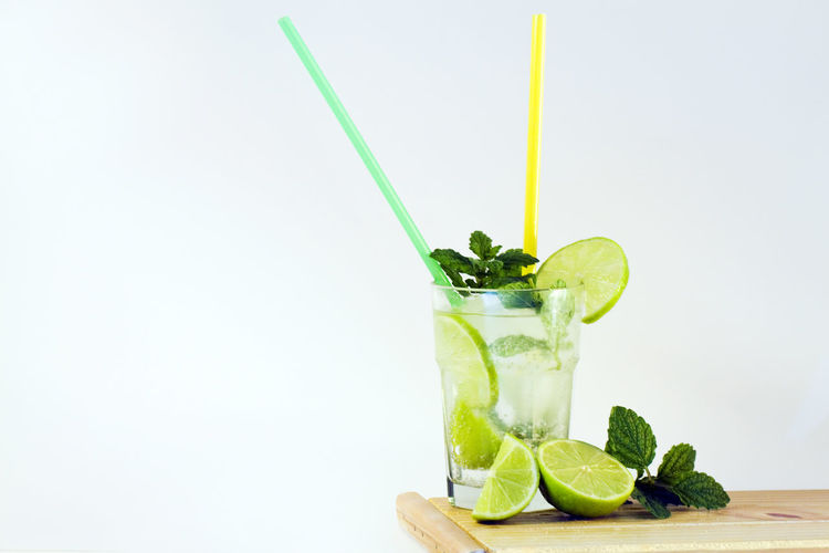 Refreshing! Alcohol Blended Drink Citrus Fruit Close-up Cocktail Drink Drinking Glass Drinking Straw Focus On Foreground Food Food And Drink Freshness Fruit Green Color Leaf Lemonade Lime Mint Leaf - Culinary Mojito Refreshment SLICE Studio Shot Tropical Drink White Background