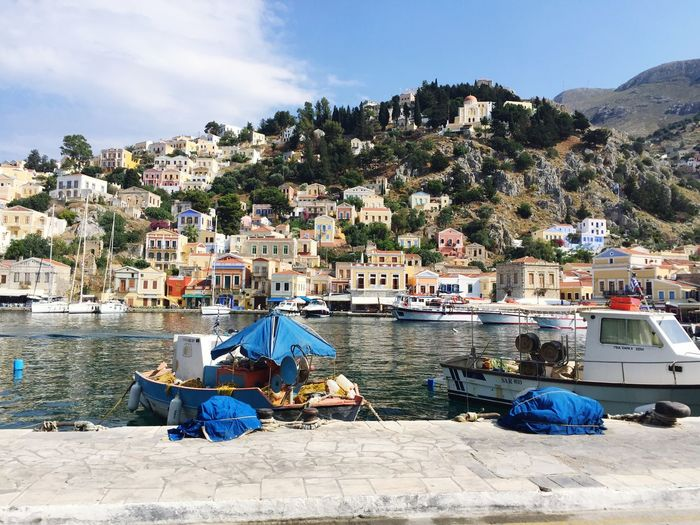 Symi, Greece. Fishing Boat Fishing Traveling Travelphotography Travel Photography Travel Destinations Travel Symi ısland Greek Islands Greece Island Life Island Boat Architecture Built Structure Building Exterior Day Transportation Mode Of Transport Nautical Vessel Water Sky Outdoors Blue No People Sea Mountain Nature Tree EyeEm Ready   EyeEmNewHere
