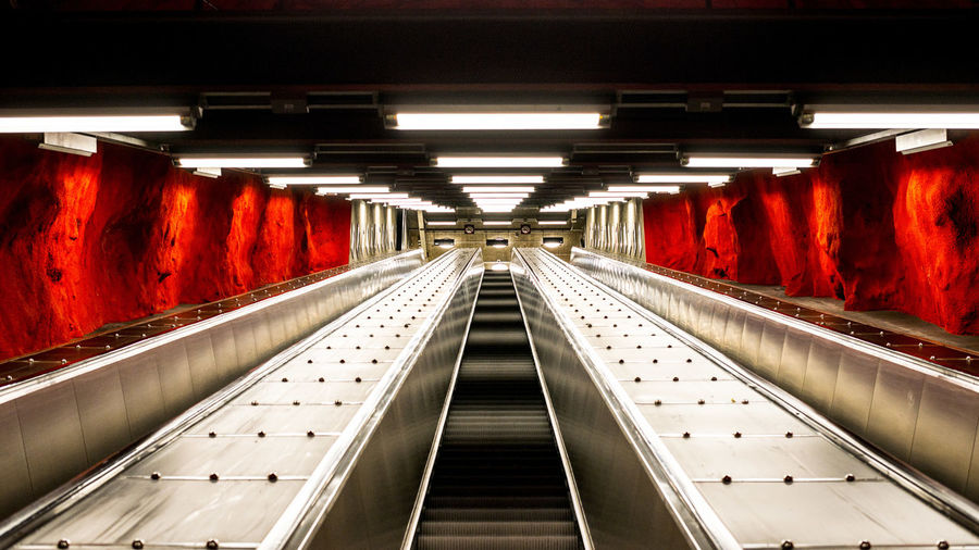 Marcweberde Illuminated Indoors  Architecture Direction Red The Way Forward Subway Diminishing Perspective Lighting Equipment Built Structure Subway Station Transportation Public Transportation Empty No People Escalator In A Row Tunnel Technology Light Ceiling Underground Walkway