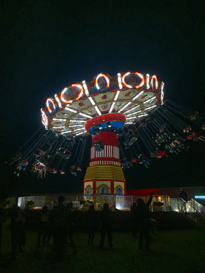 Not Bad For An IPhone Amusement Park Amusement Park Ride Arts Culture And Entertainment Carousel Enjoyment Excitement Fun Illuminated Large Group Of People Leisure Activity Low Angle View Men Multi Colored Night Outdoors People Real People Sky