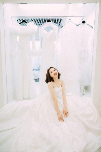 Bride among wedding dresses Bride Wedding Dress Smiling Happiness