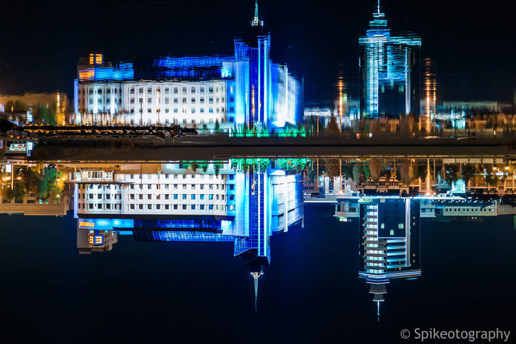 Building Exterior Night Built Structure Reflection Architecture Water Illuminated City Building Waterfront No People Nature Residential District Glowing Symmetry Blue Outdoors City Life Cityscape Office Building Exterior Skyscraper Financial District