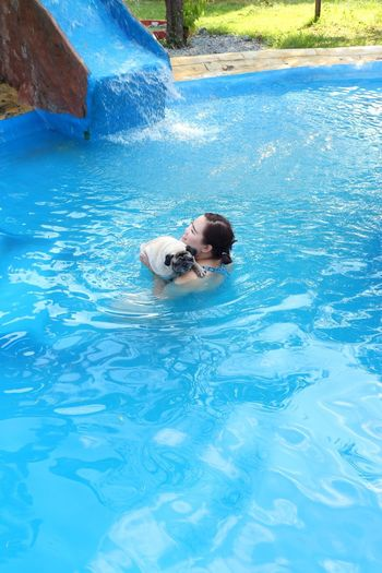 Portrait of woman swimming in pool