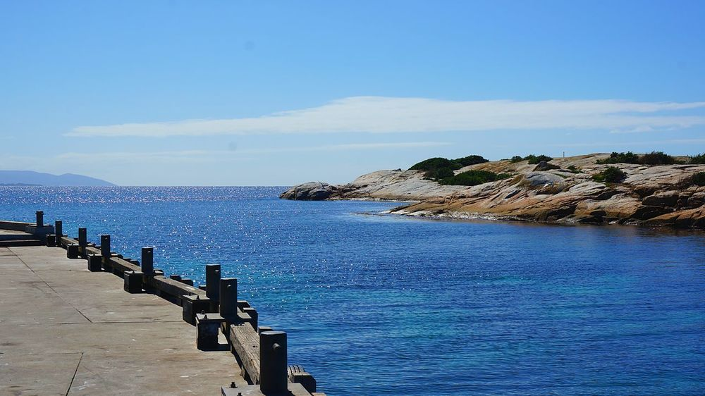 Sheltered harbour. Blue Calm Coastline Day Dock Harbour Horizon Over Water Inlet No People Ocean Rock - Object Rock Formation Sea Seascape Sky Tranquil Scene Water