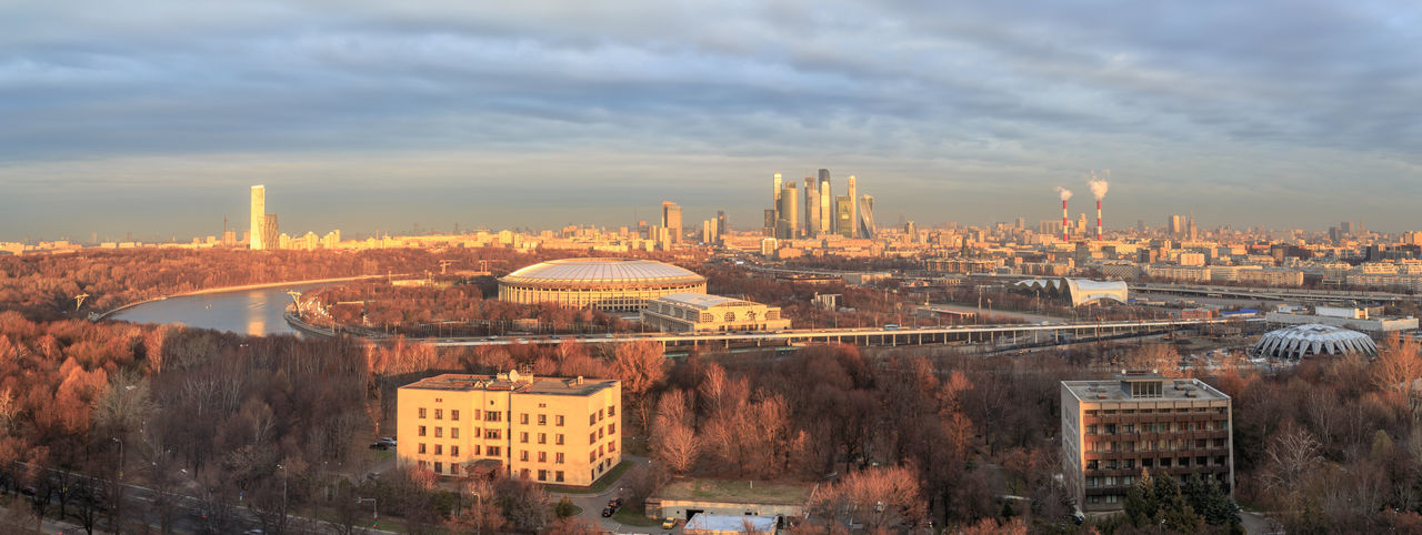 Morning view over the Moskva River to the city of Moscow with the Luzhniki Stadiumi Moskva River Golden Hour Sunrise Urban Skyline Panorma Financial District  Stadium Luzhniki Moscow Skyscraper Outdoors High Angle View Travel Connection Day Travel Destinations Building Cityscape Cloud - Sky City Sky Built Structure