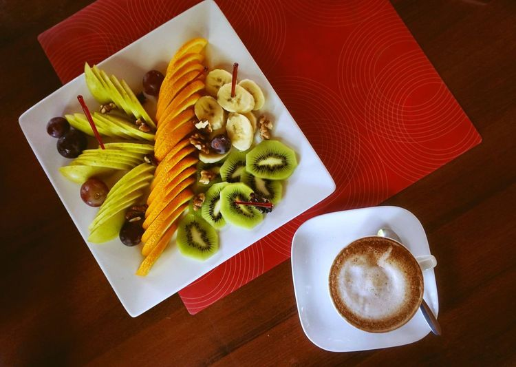 Fruit salad served with coffee