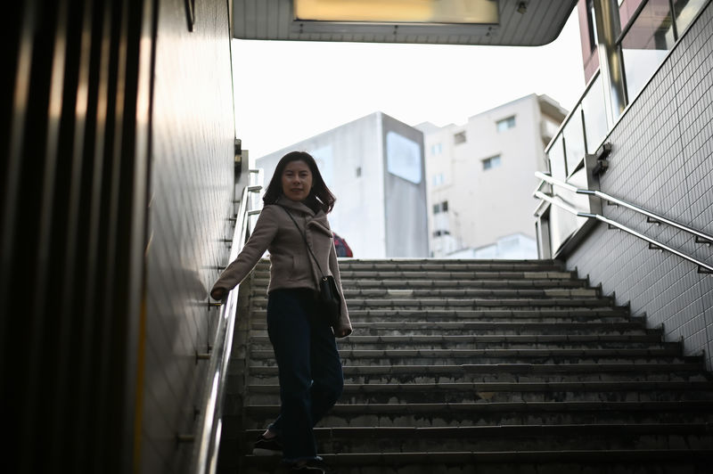 Low angle portrait of woman standing on staircase