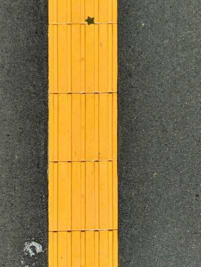 High angle view of yellow lines on road