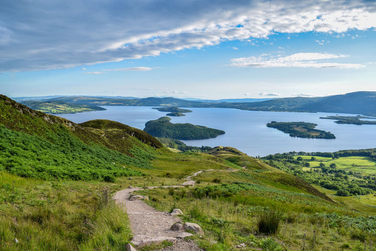 The view from Conic Hill Conic Hill Highlands Historic Loch Lomond Freshwater Lake Water Landscape Islands Scenics Beauty In Nature Nature Cloud - Sky Outdoors Tranquility No People Beach Sky Vacations Day Tree Scotland West Highland Way Trail Trekking
