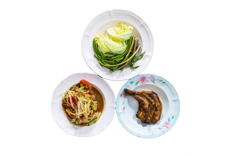 High angle view of food on table against white background