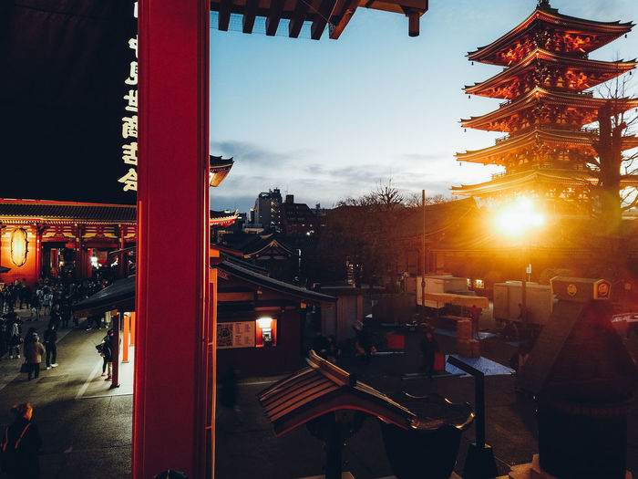 Travel Destinations Travel Urban Landscape Tokyo Japan Asakusa Worship Winter People Holiday Japan Travel Tourism Tourist Architecture Sky Built Structure Illuminated Sunset Building Exterior Nature City Orange Color Lens Flare Incidental People Outdoors Real People Men Sunlight Sun Group Of People Transportation Building City Life My Best Photo