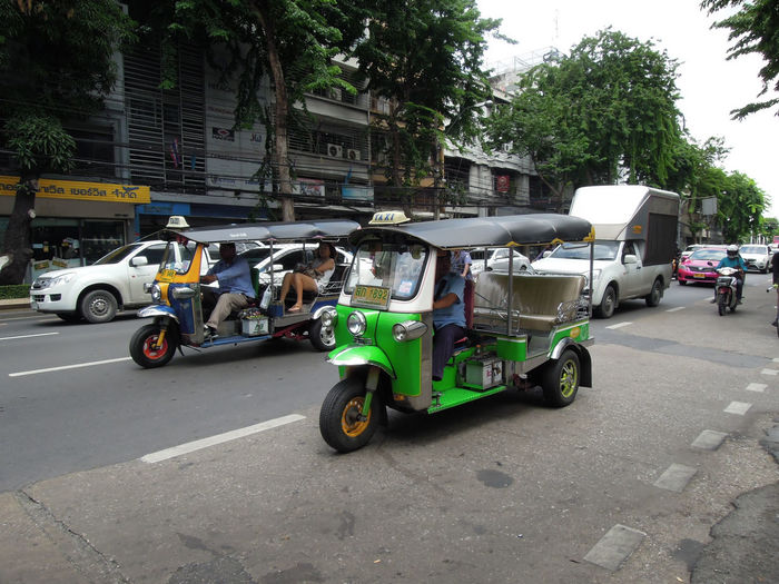 Side view of vehicles parked on road