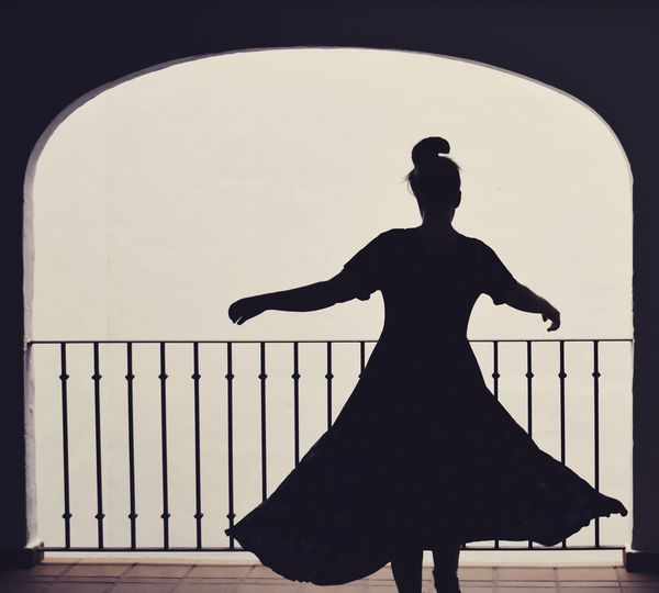 Spinning Around Dancing Silhouette Real People Standing Railing One Person Architecture Full Length Leisure Activity Lifestyles Arts Culture And Entertainment Adult Three Quarter Length Day Human Arm Rear View International Women's Day 2019
