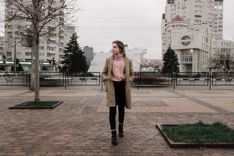 Architecture One Person City Full Length Building Exterior Built Structure Real People City Life Street Outdoors Young Adult Lifestyles Standing Front View Day Nature Plant Portrait Casual Clothing