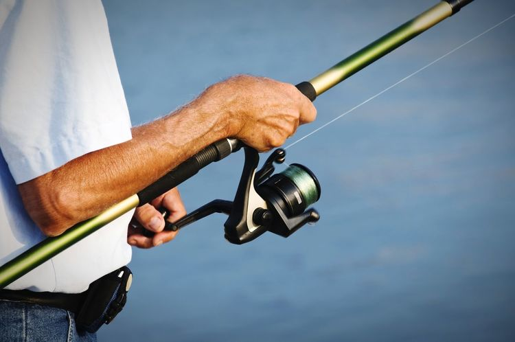 fishing Fishing Tackle Unrecognizable Person Hand Fishing Fishing Time Forearm Fishermen's Life Fisherman Outdoor Sports Human Body Part Human Hand One Man Only Sport One Person Adult Holding