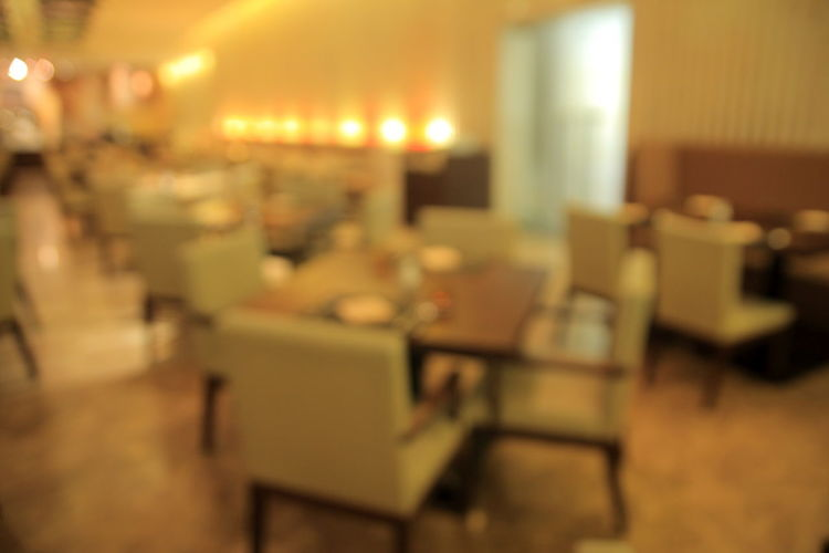Blurred photo of restaurant at hotel Chair Close-up Illuminated Indoors  Interior; Decoration; Cafe; Bar; Travel; Coffee; Life; Celebrate; Light; Sunshine; Decorative; Texture; Design; Relax; Motion; Blur; Vintage; Background; Webdesign; Hotel; Food; Bokeh; Wallpaper; Defocused; Off; Copy; Urban; Bright; Restaurant; Blurred; B Night No People