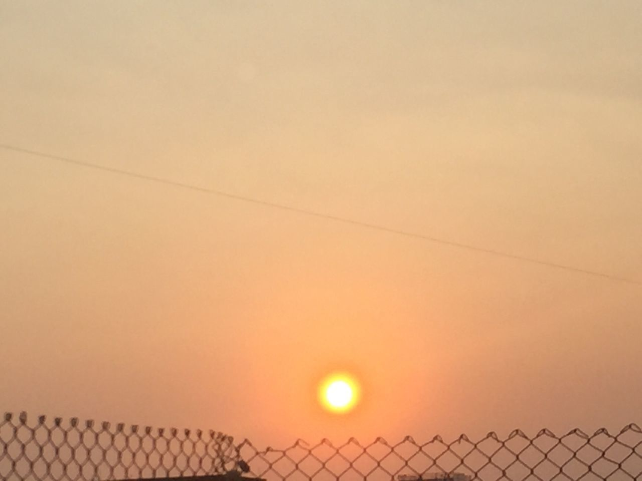 sunset, sun, orange color, nature, sky, beauty in nature, no people, outdoors, scenics, low angle view, architecture, building exterior, day